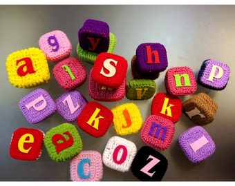Crocheted blocks with rattles and felt letters