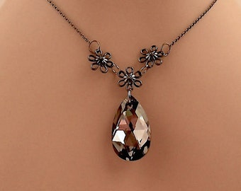 Large Swarovski Crystal Pendant Surrounded By Three Small Gunmetal Flowers On A Gunmetal Chain