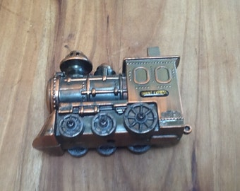 Vintage orient express cigarette lighter. Copper colour