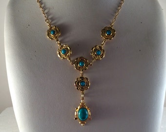Gold plated brass seven flower necklace with gold plated brass chain and turquoise stones.