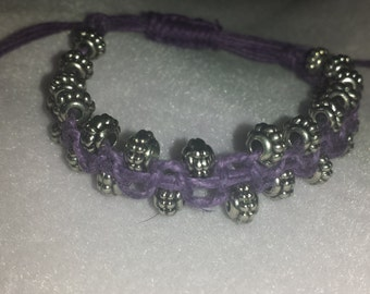 Purple hand knotted bracelet with silver beads