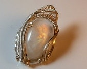 Rainbow Moonstone Cabochon Wire Wrappped In Silver Pendant