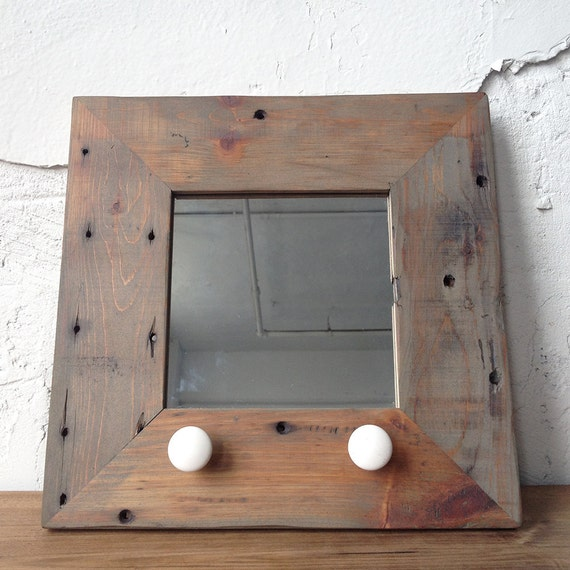reclaimed wood mirror with antique ceramic