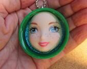 SALE - Merida   - green upcycled plastic bottle cap doll face pendant