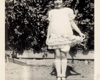 vintage photoYoung Flapper ERa Little Girl Ruffled Dress Holding Out in Curtsy
