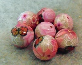 round polymer clay beads with pink flowers and monarch butterfly