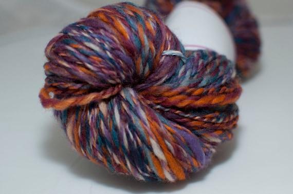 Merino Handspun Yarn in Shades of Purple and Orange 100g/176yds