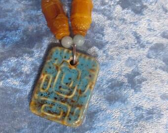 Orange and blue glass pendant necklace