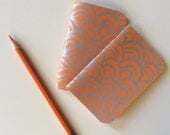 tiny orange notebook, screen printed in silver ink, filled with Tomoe River paper