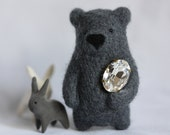 A dark grey bear brooch