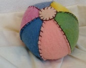 Wool felt baby ball naturally dyed with rattle inside