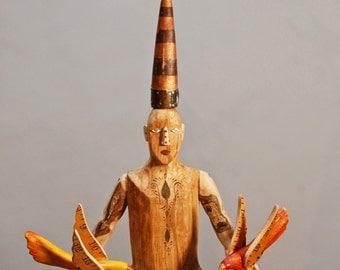 Bird Man- a carved aspen and reclaimed wood sculpture