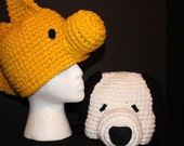 2 custom hats - white dog with black ears and a golden bird hat - inspired by Snoopy and Woodstock