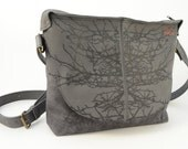 Grey leather tote with black print