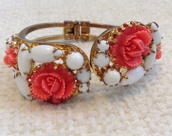 Vintage Clamper BRACELET. Gold metal with white glass stones and coral celluloid flowers.  Vintage 1950.