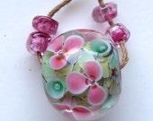 Destash Lampwork Glass Floral encased floral focal bead pink green