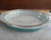 Vintage Aqua Blue Pyrex Oven Ware with Gold Swirled Lid Covered Casserole dish Primary colors Retro kitchen