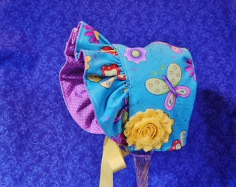 Turquoise Baby Bonnet with Butterflies and Flowers