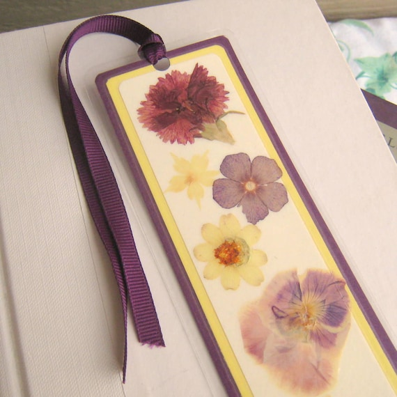 Purple and yellow pressed flower floral collage laminated