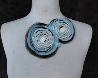 Cute   embroidered  and beaded flower  applique