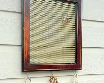 Earring Holder or jewelry organizer made from a vintage rustic wood frame, and a gold metal insert plus three hooks for holding jewelry