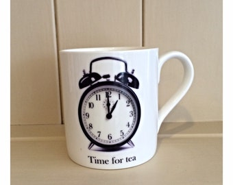 Amser Paned or Time for tea mug featuring a glossy black alarm clock from Wales.