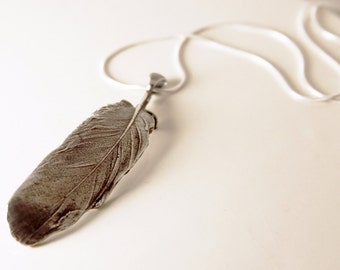 baby bird feather pendant, solid sterling silver, cast from a real bird feather, annie montgomery jewelry