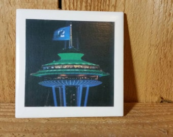 Seattle Space Needle, in Seahawks colors, with the number 12 flag, set of 4 coasters