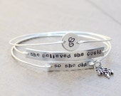 RN bracelet - She believed she could, so she did - Nurse bracelet - set of 3 wired stamped bangles with an initial and RN charm