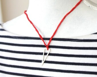 silver heart on red necklace