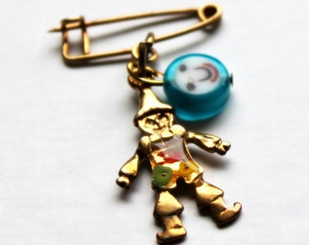 golden clown brooch