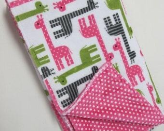 Giraffe blanket with pink polka dot backing