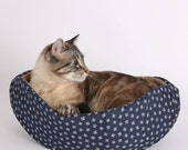 The Cat Canoe Kitty Bed in Navy Flowers and Tan Cotton Fabric