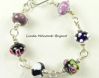 Silver Bracelet of Black White and Purple Lampwork Beads