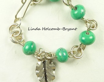 Bracelet of Turquoise Lampwork Beads with Leaf Charm