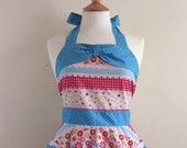 Retro apron, vintage style pink, red and blue pattern on a white fabric, fully lined.