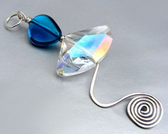 Cerulean blue pendant with rainbow flash, sterling silver hammered wire wave & spiral // Blue Wave