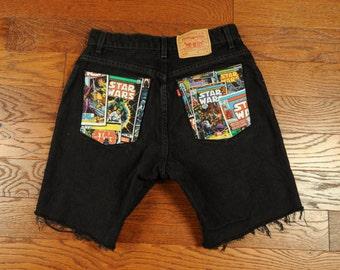 Star Wars shorts black denim jean shorts Levi's 550 cut off cutoff shorts Star Wars comic material fabric applique 30 waist Made in USA