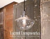 Lighting With Tapered Globe in Clear Glass with Exposed Socket Design