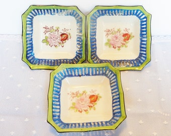 Three small square porcelain dishes with cut out design, hand painted in green and blue with pink flower. Made in Japan, Tashiro Shoten LTD