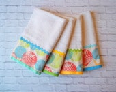 Colorful Sea Shell Cotton Towels, on Gray  Background.