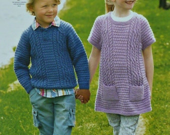 Childrens Knitting Pattern K4374 Childrens Long Sleeve Cable Jumper & Cable Dress with Pockets Knitting Pattern DK (Light Worsted) King Cole