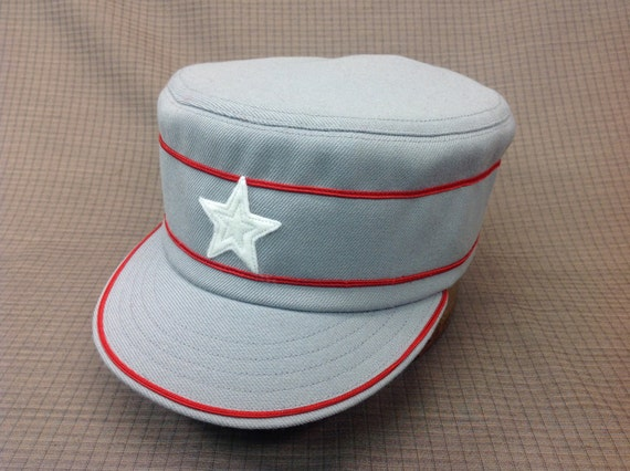 Custom made light grey wool serge box cap trimmed in red soutache, with 1910 visor, haircloth stiffener, white felt star, cotton sweatband.