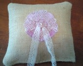 Tan burlap ring pillow lavender embroidered medallion in middle