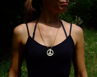 Leather necklace with horn peace sign