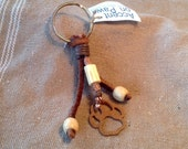 Brown Textured Metal Paw Keychain with leather and dogwood