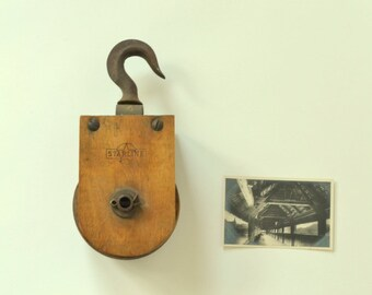 industrial wood and iron pulley - starline - farm pulley