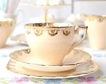 Peachy English tea cup, saucer and plate: Wellington bone china tea set with soft peach pink and vibrant gold detailing, a lovely gift