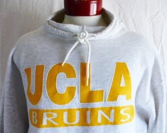 Go Bruins vintage 90's UCLA University of California Los Angeles heather grey fleece graphic sweatshirt yellow white puffy print pullover