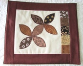 Handmade machine appliqued mug rug made in lovely shades of brown and green